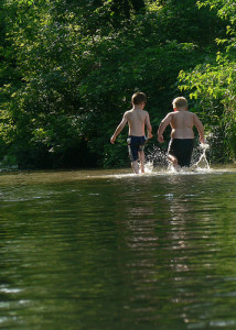photo credit: two boys playing in river via photopin (license)